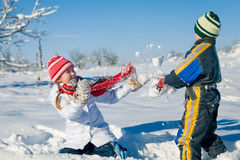 Happy little children playing  in winter snow day. Stock Photos