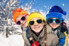 Happy little children playing  in winter snow day. Royalty Free Stock Photos