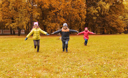 Happy little children running and playing outdoors Royalty Free Stock Photography