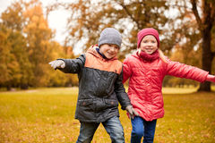 Happy little children running and playing outdoors Stock Image