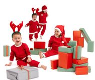 Happy little children in Santa costume stock photo