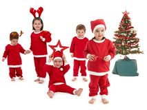 Happy little children in Santa costume Stock Photos