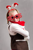 Happy little Christmas child girl with glasses 2015 Royalty Free Stock Images