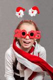 Happy little Christmas child girl with glasses 2015 Stock Photography