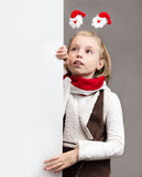 Happy little Christmas child girl . Royalty Free Stock Photography