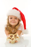 Happy little christmas girl with chocolate Stock Photo