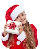 Happy little christmas girl with present Royalty Free Stock Photo