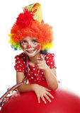 Happy little clown pointing on something Stock Images