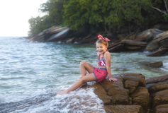 Happy little cute girl at the beach Stock Photo