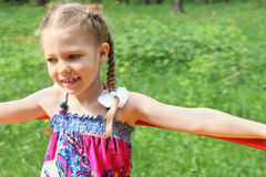 Happy little cute girl rides on roundabout Royalty Free Stock Images