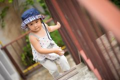 Happy little cute girl walking up the stairs. stock photos
