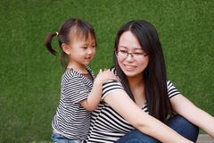 Happy little cute lovely baby girl Chinese child smile laugh have fun with mother mom at summer park nature happiness childhood. Asian Chinese little cut lovely stock photos