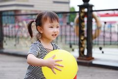 Happy little cute lovely girl Chinese child smile laugh play colorful balloon have fun at summer park nature happiness childhood. Asian Chinese little cut lovely royalty free stock photos