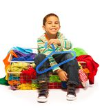 Happy little dark skinned boy want more clothes Stock Photo