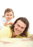 Happy little daughter sits on father Royalty Free Stock Photos