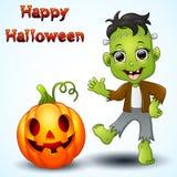 Happy little frankenstein and pumpkin cartoon Stock Photo