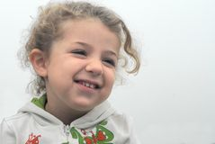 Happy Little Girl. A portrait of a cute looking girl in a happy mood Royalty Free Stock Images