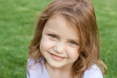 Happy little girl. Portrait of a little girl smiling Stock Photography