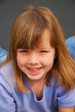 Happy little girl. Outdoor portrait of a beautiful caucasian little girl with brunette hair and happy smiling facial expression Stock Photo
