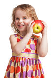 Happy little girl with an apple in his hand Stock Photos