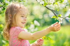 Happy little girl in apple tree garden Royalty Free Stock Photos