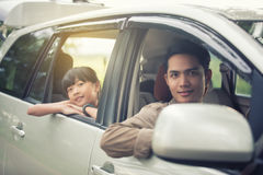 Happy little girl  with asian family sitting in the car for enjo. Ying road trip and summer vacation Royalty Free Stock Photos