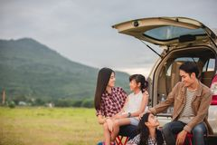 Happy little girl  with asian family sitting in the car for enjoying road trip and summer vacation in camper van royalty free stock photos