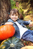 Happy little girl in the autumn Royalty Free Stock Photo