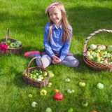 Happy little girl with autumn harvest of tomato in Royalty Free Stock Image