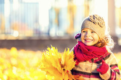 Happy little girl with autumn leaves Stock Photo
