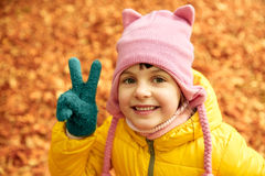 Happy little girl in autumn park Royalty Free Stock Photography