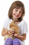 Happy little girl with a baby rabbit Royalty Free Stock Photography