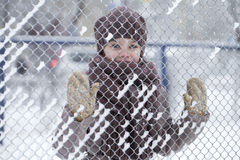 Happy little girl on the background of a winter park Royalty Free Stock Photography