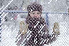 Happy little girl on the background of a winter park Stock Photo