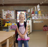 Happy little girl with backpack Royalty Free Stock Images