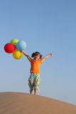 Happy little girl with balloons Stock Photos