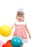 Happy Little Girl with Balloons Royalty Free Stock Image