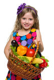 Happy little girl with a basket of vegetables Royalty Free Stock Image