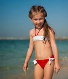 Happy little girl on the beach Royalty Free Stock Image