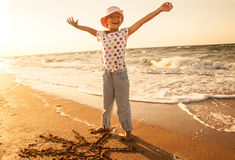 Happy little girl at the beach royalty free stock photo