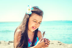 Happy little girl on the beach. Stock Photo