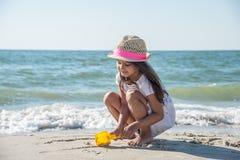 Happy little girl on the beach Stock Photos