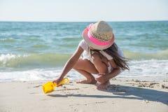 Happy little girl on the beach Royalty Free Stock Photos
