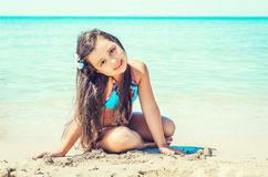Happy little girl on the beach. Royalty Free Stock Photos