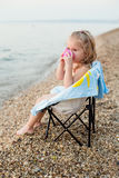 Happy little girl on the beach Stock Photography