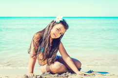 Happy little girl on the beach. Royalty Free Stock Images