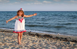 Happy little girl on beach summer scene Royalty Free Stock Photography