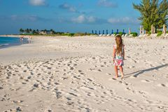 Happy little girl on beach during summer vacation Royalty Free Stock Photos