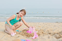 Happy little girl on the beach Stock Images
