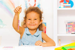 Happy little girl with beads on a string Stock Photo